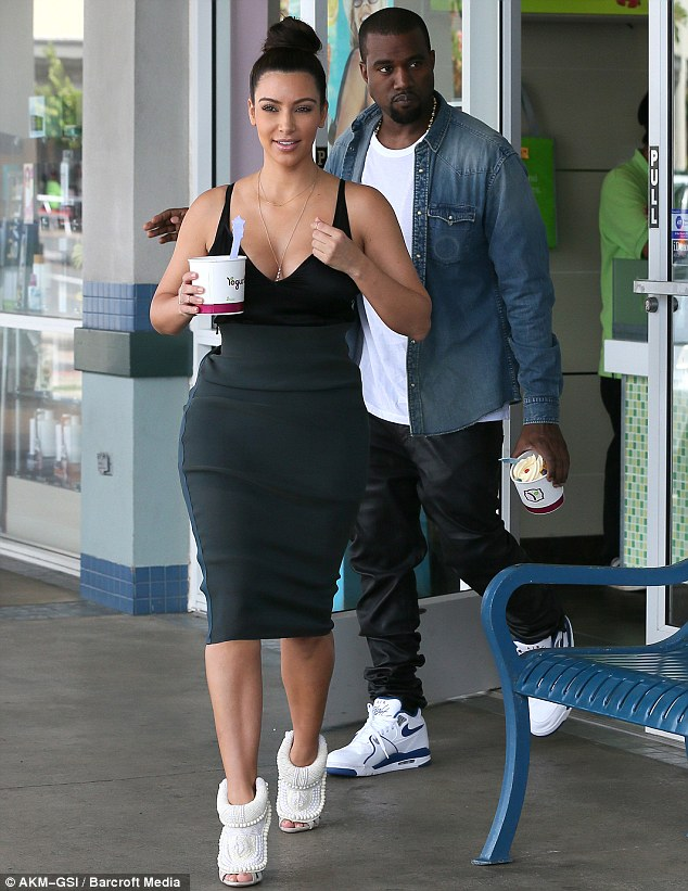The happy couple: Kim has been supporting boyfriend Kanye West in Hawaii recently while he records his new album