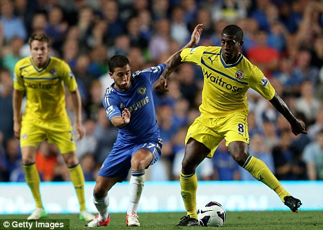 Fight for the ball: Hazard battles with Mikele Leigertwood for possession