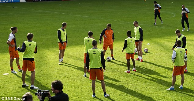 Part of the team: Carroll trains at Tynecastle with the rest of the Liverpool squad