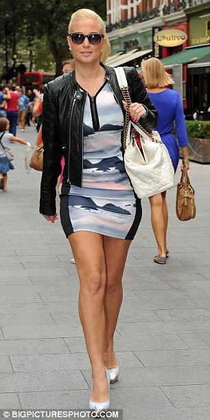 Street style: Tulisa showed off her legs in a short dress which she teamed with a leather jacket and high heels