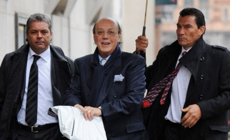 Deception: Asil Nadir (centre) was found guilty of stealing £29million from his own company