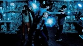 Fighting Death Eaters in the Hall of Prophecies.
