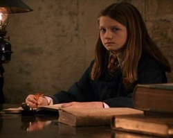 Ginny writing in Tom Riddle's diary.