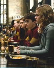 Ginny with Harry and Hermione before the first Quidditch match of the season.