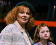 Ginny and Mrs. Weasley at King's Cross station.
