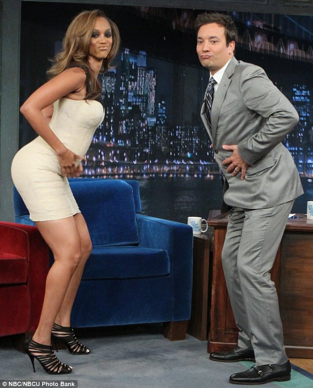 'Booty tooch': Tyra showed Jimmy how to do a pose from America's Next Top Model and the talk show host was a great sport