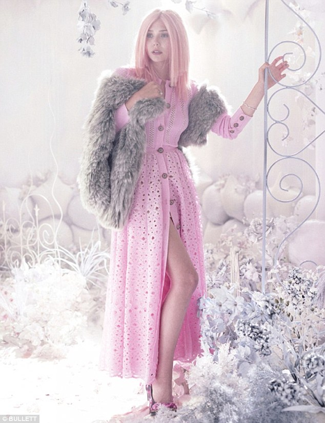 Leggy: The starlet gets leggy in a baby pink broderie anglaise button-up gown paired with a fur stole