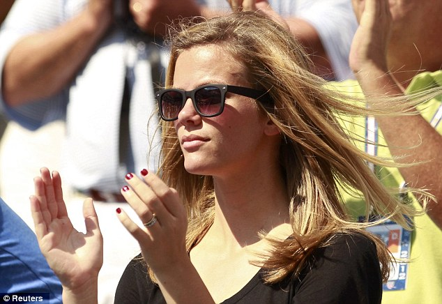 She's got the look: The Sports Illustrated model shielded her eyes from the sun's glare in black wayfarers