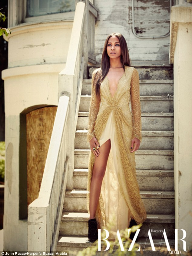 A perfect contradiction: The 34-year-old actress managed to pull off soft and edgy in a floor-sweeping gold lace dress, paired with black ankle boots and dark accessories