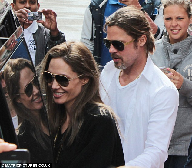 British break: Brad Pitt and Angelina Jolie (pictured in France over the weekend) are said to be planning a holiday in the Lake District with their brood