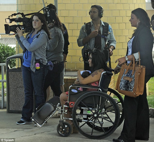 Smile for the camera: MTV crew members were on hand to capture Snooki's journey every step of the way