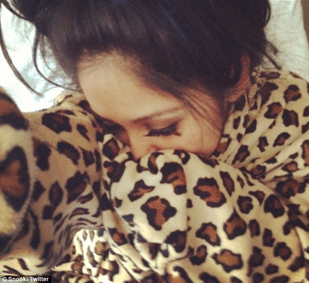 'I'm legit an old lady': New mother Snooki snuggles up in leopard print robe in first picture since giving birth