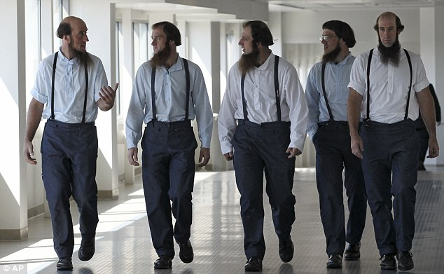 Support: Members of the Amish leave the U.S. Federal Courthouse Tuesday, Aug. 28, 2012, in Cleveland after a breakaway religious group spent months planning hair-cutting hate attacks against followers of their Amish faith