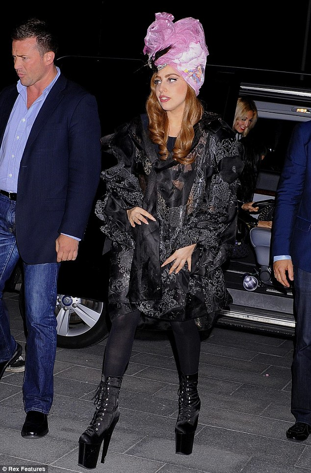 Tottering along: Gaga wore her trademark platform boots and an over sized coat