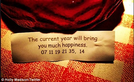 Good fortune: Holly today posted this snap of a fortune cookie slip which read: 'The current year will bring you much happiness'