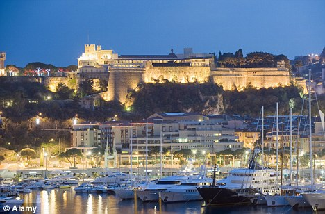 Playground for the rich and famous: The Palais du Prince and harbour in the Port of Monaco by night
