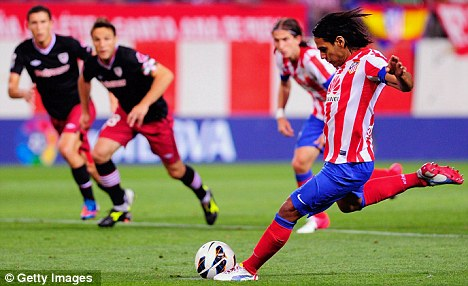 Up and running: Falcao got his season started with a hat-trick against Athletic Bilbao on Monday night, including this penalty