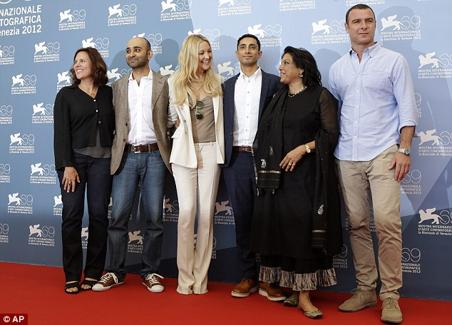 Cast photo: The film's producer Lydia Dean Pilcher, writer Mohsin Hamid,  Hudson, actor Riz Ahmed, director Mira Nair, and actor Liev Schreiber pose on the red carpet for the photo call