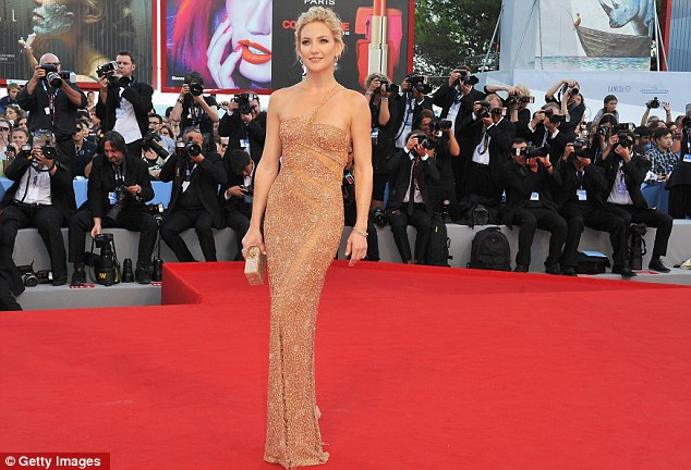 Snap happy: The clinging nude number showed off the Hollywood star's enviably svelte figure