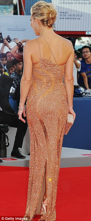 Looking good: Kate teamed her stunning nude gown with Faberge jewellery to stunning effect