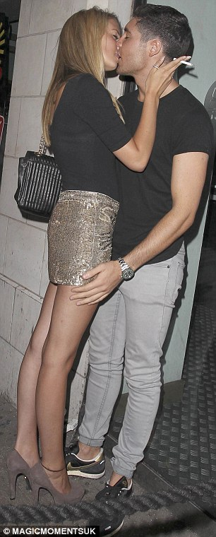 Hands on: The cheeky Essex lad was seen placing his hand on the blonde's derriére