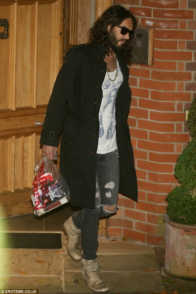 Why so glum? Russell Brand looks miserable as he leaves Geri Halliwell's home on Wednesday night