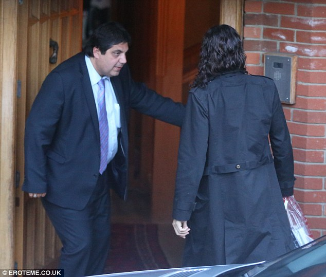 Come in sir: Russell was greeted by a male member of security earlier on in the evening