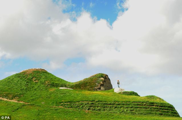 Let's hope she doesn't sneeze: A solo figure stands on Northumberlandia's upper lip