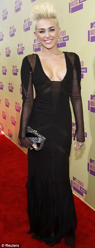 Gothic glamour: Miley Cyrus tried out another new look in a plunging black dress at the MTV Video Music Awards tonight