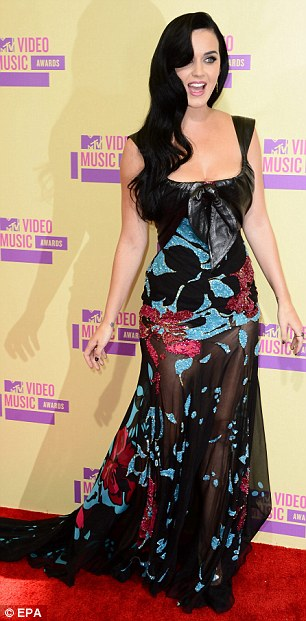 Va va voom: Katy Perry brought lots of sex appeal to the red carpet in her black dress with colourful detailing and a sheer skirt