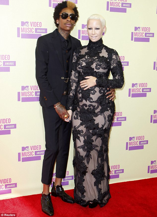 Oh baby: Amber Rose showed off her blossoming baby bump in a lace form-fitting dress