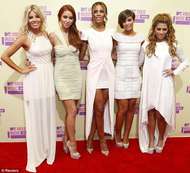 Coordinated: The Saturdays looked lovely in Grecian inspired dresses as they posed up together