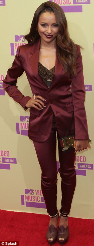 Glamour girls: Kat Graham flashed her bra in a burgundy suit while Jessica Szohr vamped it up in a split black dress