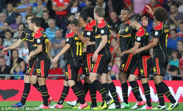 Well done: Belgium celebrate with scorer Kompany