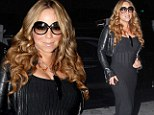 Dressed to impress: Mariah Carey arrived to New York's JFK airport in New York on Thursday in a floor-length flamenco-inspired dress for a flight to Tokyo