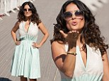 Work those moves: Salma Hayek pulls off several model poses as she dazzles at French film fesitval