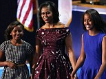 First lady Michelle Obama takes to the stage with her daughters Sasha and Malia on the final day of the DNC