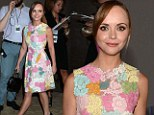 Christina Ricci comes up roses in a pretty pastel dress as she attends New York fashion show