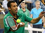 On the court: Adam Sandler and John McEnroe get ready to serve up Kevin James and tennis champion Jim Courier (not pictured) at a U.S. Open exhibition match on Thursday