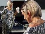 Something Different About Mary... Wild cat Cameron Diaz sports cheetah tattoo on her neck on set of The Counselor