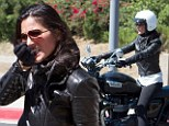 She's born to be wild! Olivia Munn gets her motor running by taking ride on chopper