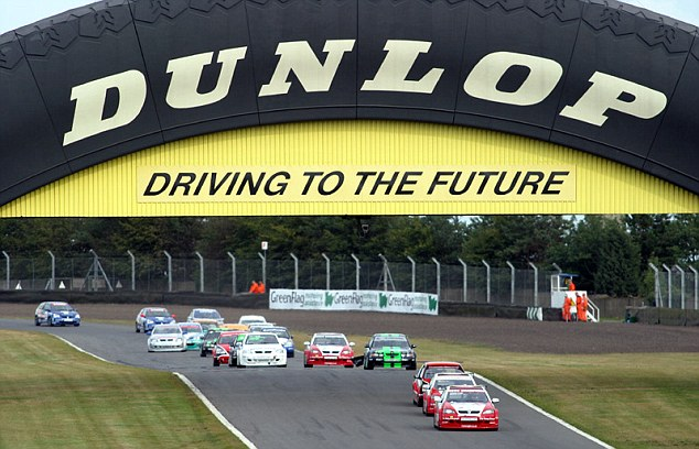Race cars whiz under the Dunlop bridge, which became a key feature of the race track. The bridge is expected to fetch £50k when it is auctioned