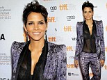 Halle Berry shows off her lacy bra under a see-through top as she arrives at Toronto premiere in striking blue suit
