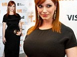 She sure knows how to dress those curves! Christina Hendricks shows off some leg in a split black dress at film premiere