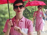 Anne Hathaway looks after her pale skin when walking through New York City