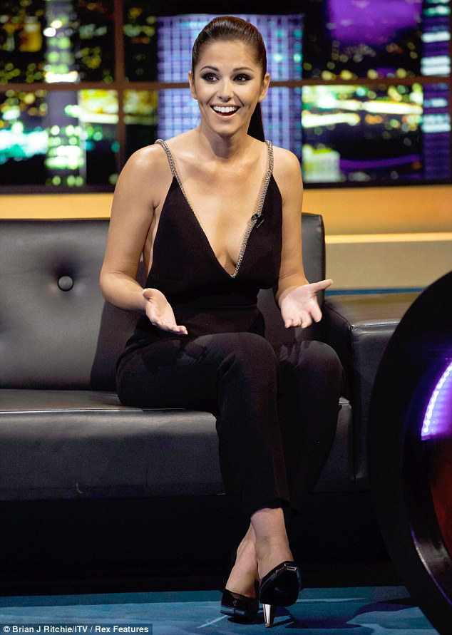 Hidden agenda: Cheryl Cole opted to wear a low cut black jumpsuit as she appeared on the Jonathan Ross Show