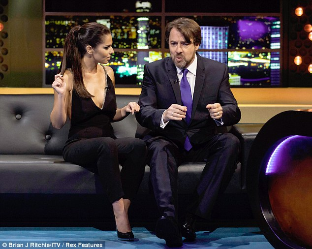 Chit chat: The singer got down to some serious talk with Jonathan Ross as the pair got close on his sofa