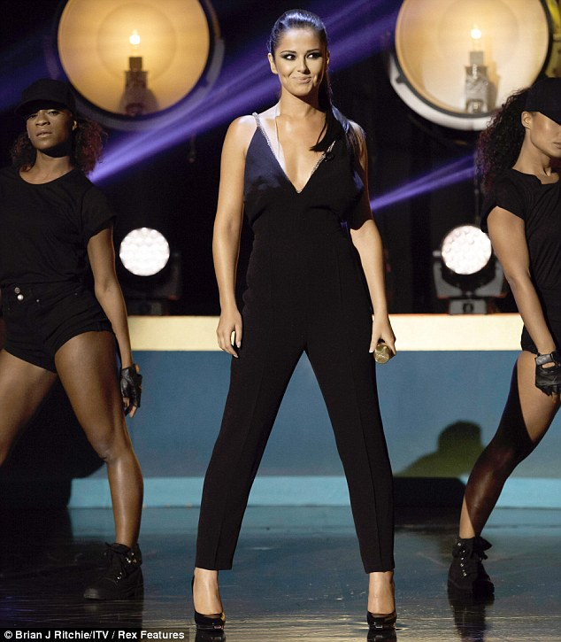 Centre stage: Cheryl looked amazing in her all black outfit and completed the ensemble with some dark make-up