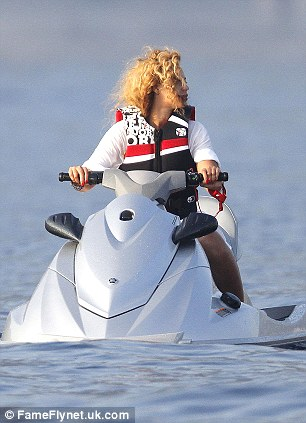 B at sea: The singer wore a white shirt and life-jacket over her swimsuit