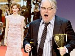 Philip Seymour Hoffman pays tribute to Joaquin Phoenix as they BOTH win Best Actor at Venice Film Festival